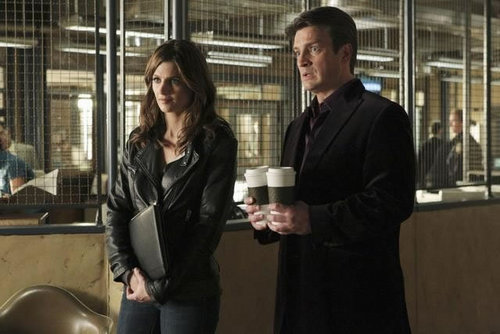 Kate Beckett দেওয়ালপত্র containing a business suit and a revolving door titled Castle_3x11_Nikki Heat_Promo pics