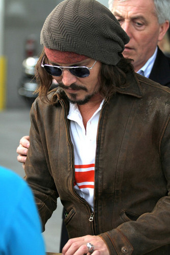 Johnny Depp wallpaper called Johnny Depp and Family at a Miami Dolphins Game - Dec 19 2010