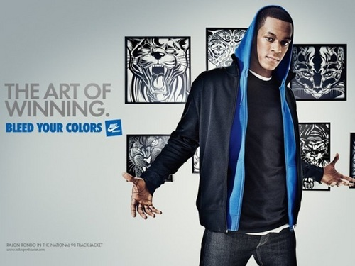 Rajon Rondo Hintergrund containing a well dressed person, an outerwear, and long trousers called Rajon Rondo
