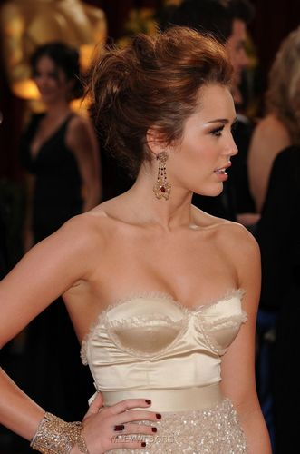 Miley Cyrus wallpaper probably containing a bridesmaid and a dinner dress entitled 18th Annual Elton John Aids Foundation,Oscar Party,07.03.2010
