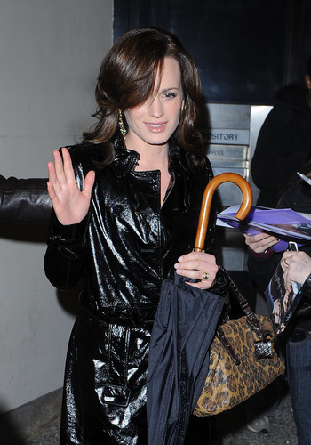 Elizabeth Reaser wallpaper probably containing a parasol titled New/Old candids of Elizabeth outside the MTV studios.