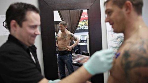 Tom with tattoo artist