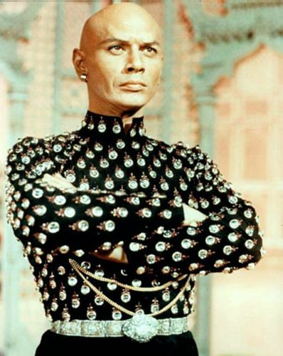 Yul Brynner wallpaper probably with a dashiki, an outerwear, and a surcoat titled Yul Brynner