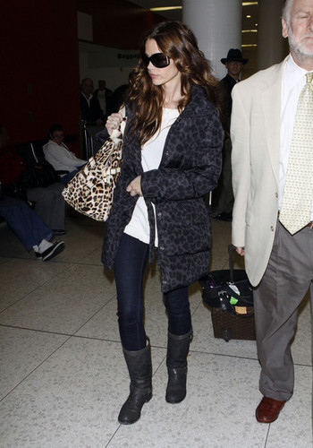 Denise Richards wallpaper containing sunglasses, a fur coat, and a business suit titled Denise @ LAX