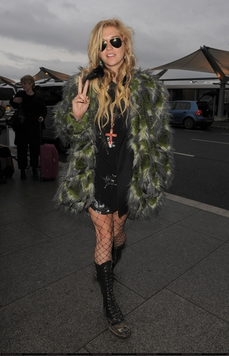 Ke$ha arriving at Heathrow Airport in London 12/16/10