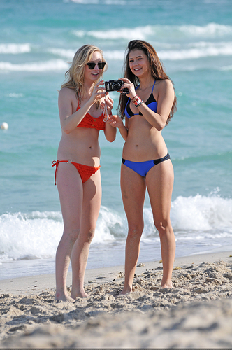 Candice Accola fondo de pantalla with a bikini entitled New/Old fotos of Candice and Nina at South Beach, Miami (HQ)