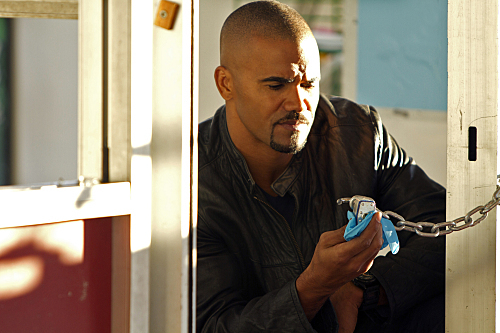 Shemar Moore wallpaper possibly with a sign and a holding cell titled Shemar Moore/Derek Morgan