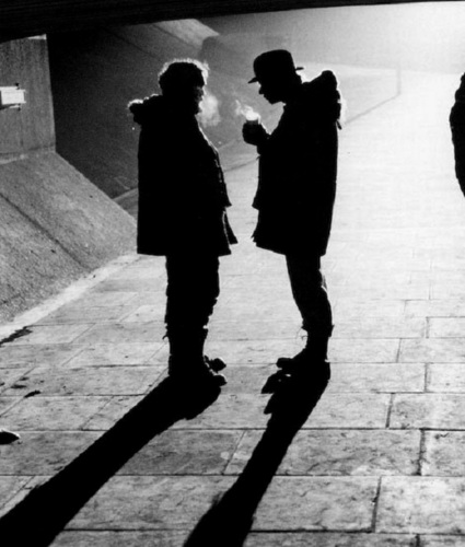A Clockwork Orange wallpaper with a business suit and a street entitled Stanley Kubrick & Malcolm McDowell on the set