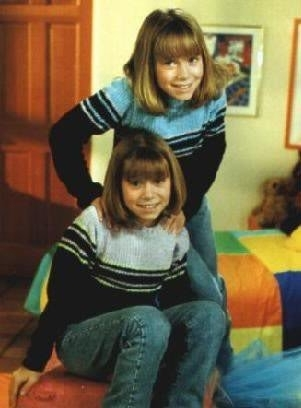 Mary-Kate & Ashley Olsen wallpaper probably with a tabard called You're Invited To Mary-Kate And Ashley's Costum Party