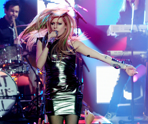 एव्रिल लावीन वॉलपेपर possibly with bare legs, hosiery, and a hip boot called Avril WTH (Live) at Dick Clark's NYE