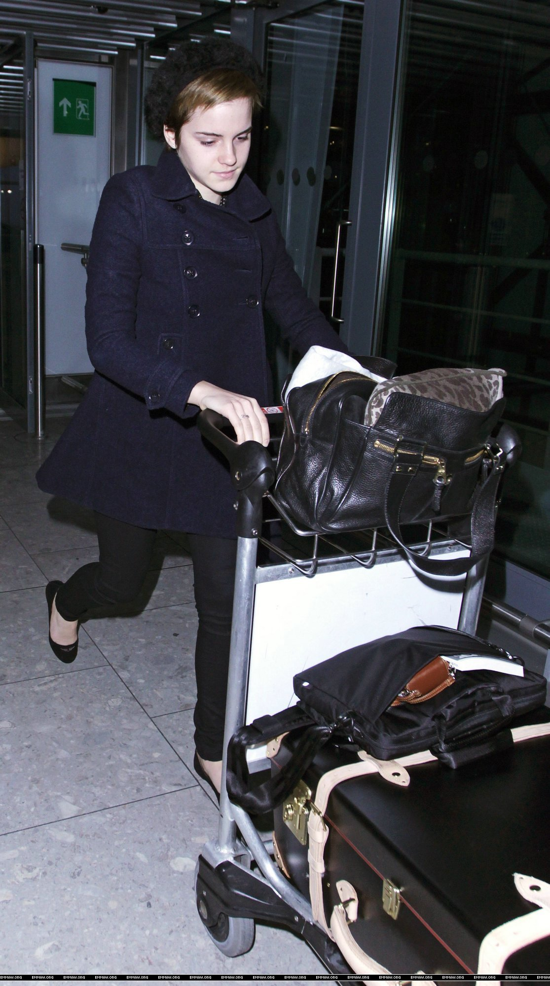 Emma Watson at Heathrow Airport On Friday (December 31st)