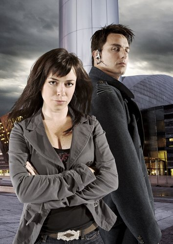 Torchwood wolpeyper containing an outerwear, a well dressed person, and an overgarment called Gwen & Jack
