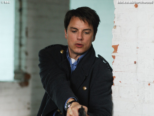 Torchwood wolpeyper with a business suit and a well dressed person called Jack Harkness