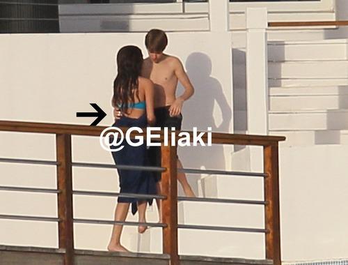 Justin and Selena touching