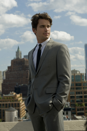 White Collar wallpaper with a business suit, a suit, and a two piece entitled Neal Caffrey