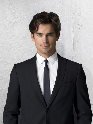 White Collar wallpaper with a business suit, a suit, and a double breasted suit titled Neal Caffrey