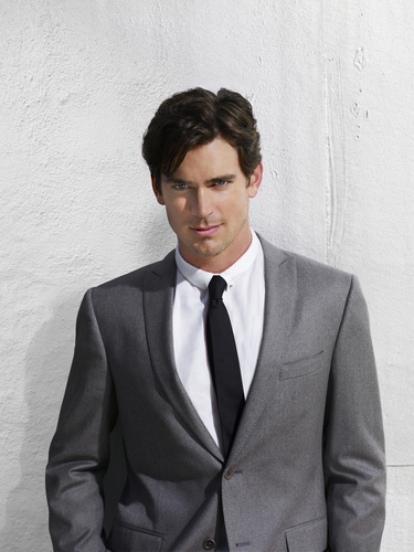 White kwelyo wolpeyper containing a business suit, a suit, and a double breasted suit titled Neal Caffrey