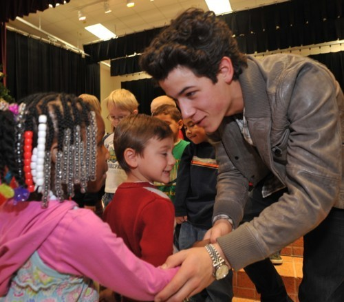 Nick with fans:))