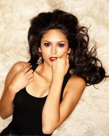 Katherine Pierce Hintergrund probably containing attractiveness, a portrait, and skin called Nina Dobrev