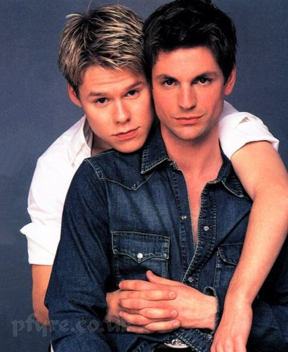 Queer As Folk wallpaper possibly containing an outerwear, a sign, and a leisure wear entitled qaf