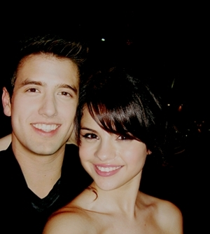 Logan Henderson wallpaper containing a portrait and skin titled logan and selena