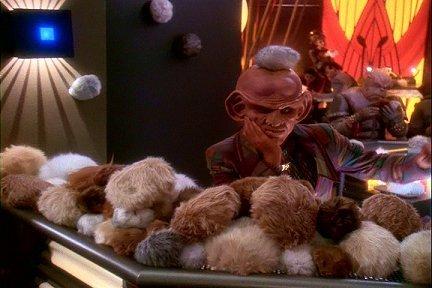 Quark surrounded oleh Tribbles