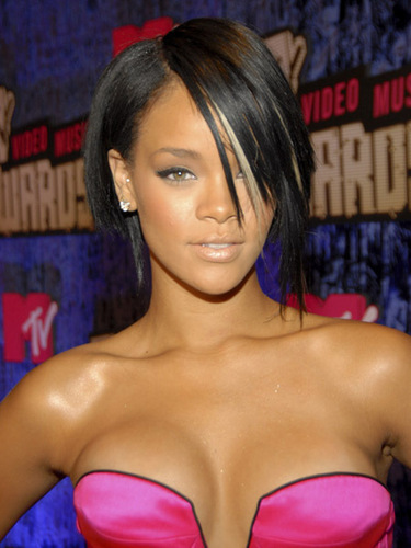 Rihanna wallpaper probably containing attractiveness, skin, and a portrait called Rihanna