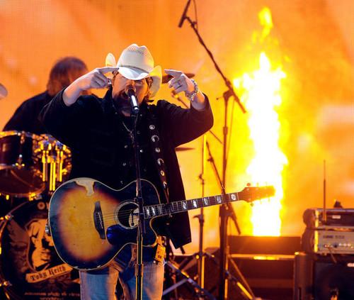 Toby Keith performing at the ACA awards