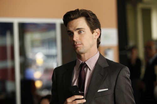 White Collar wallpaper with a business suit, a suit, and a three piece suit titled Neal Caffrey