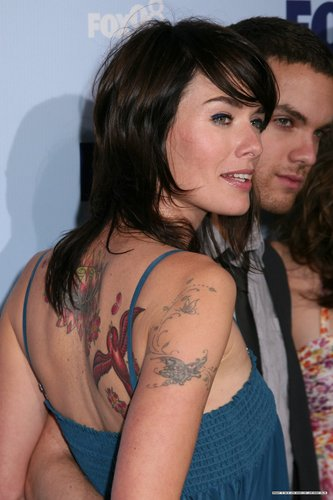 Lena Headey wallpaper probably with a portrait and skin called Lena and her tattoos :)