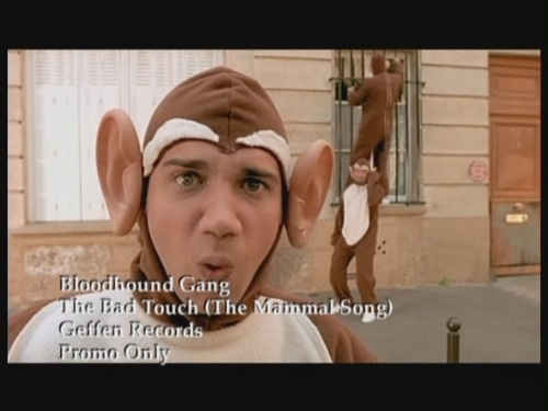 Bloodhound Gang achtergrond possibly with a sign and a portrait entitled 'The Bad Touch'