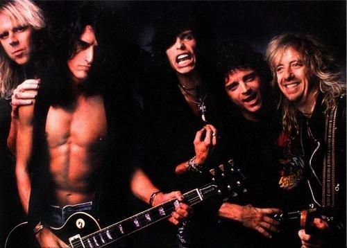 Aerosmith Hintergrund with a guitarist and a konzert entitled Aerosmith