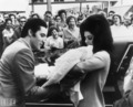 Elvis and Priscilla show off a newborn Lisa Marie to fans in 1968