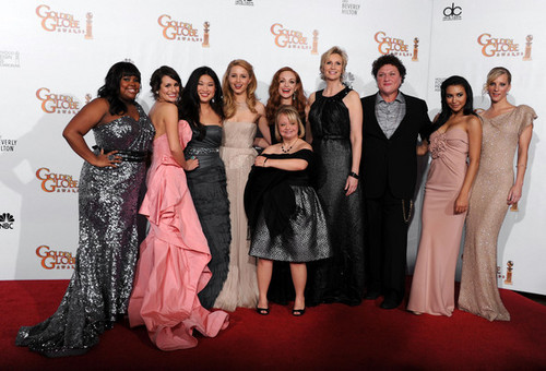 Glee wallpaper containing a bridesmaid, a dinner dress, and a gown entitled The Cast @ 68th Annual Golden Globe Awards