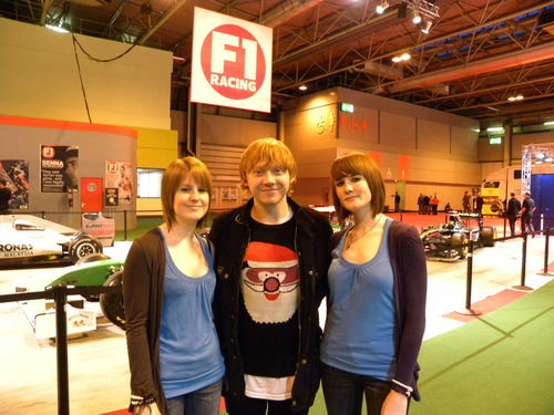 Rupert Grint wallpaper probably containing a hip boot, a playsuit, and tights titled Autosport International