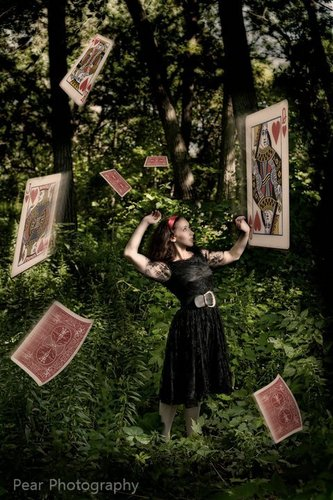 Alice In the swirl of card