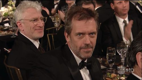 Hugh & Lisa wallpaper containing a business suit, a suit, and a dress suit entitled Hugh at the SAG Awards 2011
