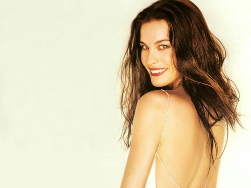Liv Tyler wallpaper possibly containing attractiveness, skin, and a portrait entitled Liv Tyler
