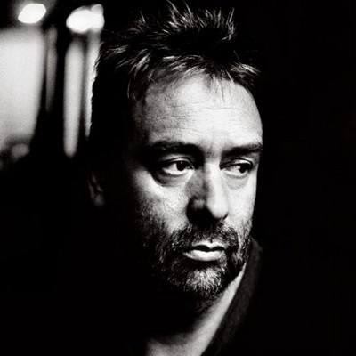 Luc Besson achtergrond possibly containing a portrait called Luc Besson