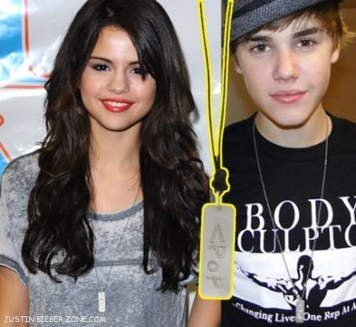 justin=selena wearin matchin P.O.P necklaces