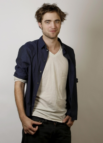 Robert Pattinson wallpaper possibly containing a well dressed person, an outerwear, and long trousers titled robert