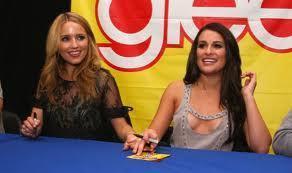 Quinn and Rachel signing autographs