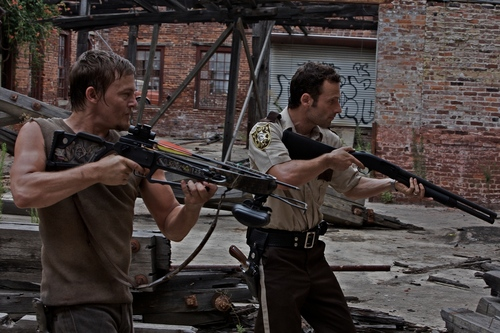 Daryl and Rick aiming.