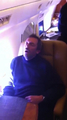 Hugh asleep on the plane to the super bowl