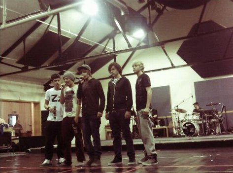 one direction wallpaper possibly containing a show, concerto and a business suit called One Direction rehearsing for their tour!