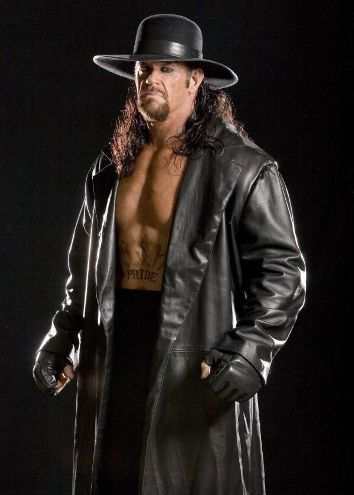 WWE wallpaper possibly containing a well dressed person, a box coat, and an outerwear entitled The Undertaker