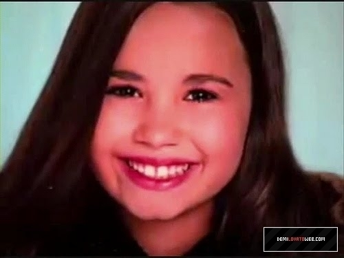 Demi Lovato wallpaper containing a portrait entitled Childhood