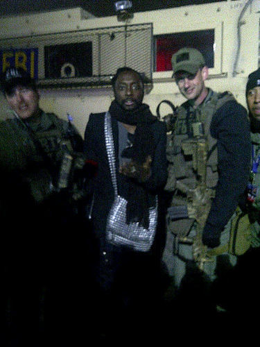 Will.i.am chilling with his security