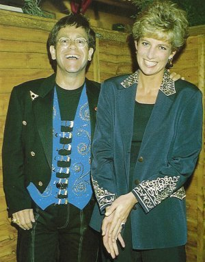 Elton John wallpaper possibly with a business suit and a well dressed person titled princes diana and elton john