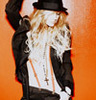 Ashlee Simpson photo possibly containing a surcoat, a shirtwaist, and a hip boot called Ashlee Icon